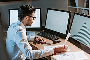 an employee reading an internal email about safety in the workplace