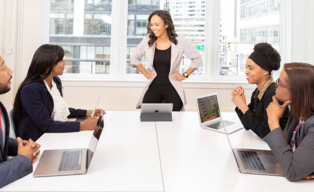 an employee from an HR consulting firm is in a session with employees of her company's client