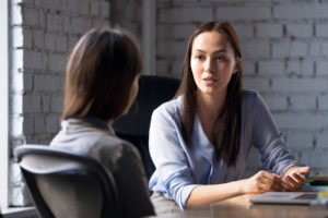 an employee speaks to a person in hr about why she needs a FMLA leave