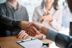 company leader shake employee hand after talking about the employee FMLA leave request