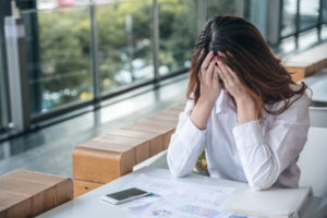employee is stressed about asking her company on taking a FMLA leave