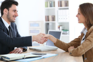 employer shake employee hand after accepting FMLA leave request