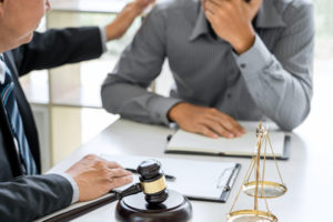 lawyer advises his client that is facing FMLA harassment at his workplace