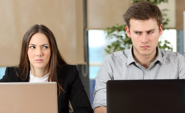 Two employees in conflict in the workplace