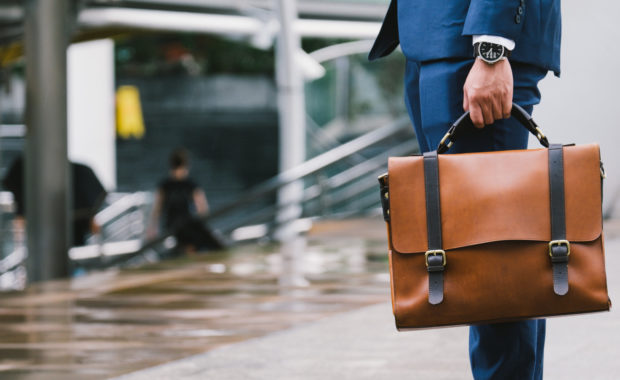 employee holding briefcase is on the way out of building after his termination of employment