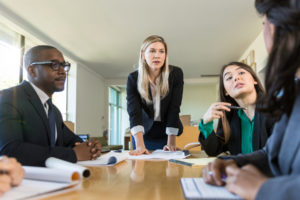 employees watch as a conflict in the workplace arises