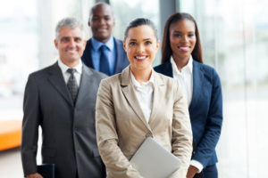 hr consultants that assist companies to be in compliance with many laws pose for picture