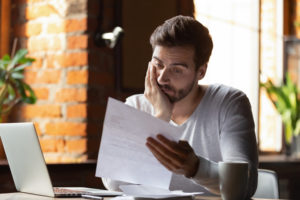 person sitting at desk reads termination letter