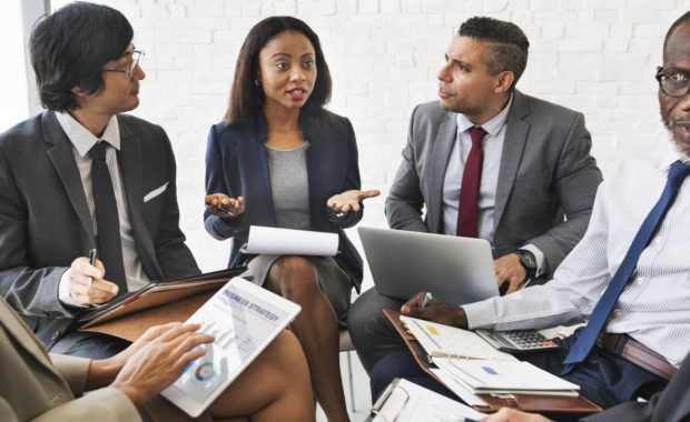 group of employees meet to discuss on how to deal with disruptive behavior in the workplace
