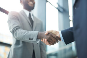 colleagues shake each other hands after the introverts and extroverts meeting