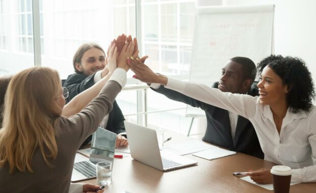 coworkers working with an introvert to help her with professional development