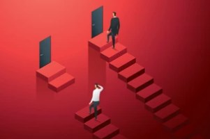 male and female employees climbing red stairs