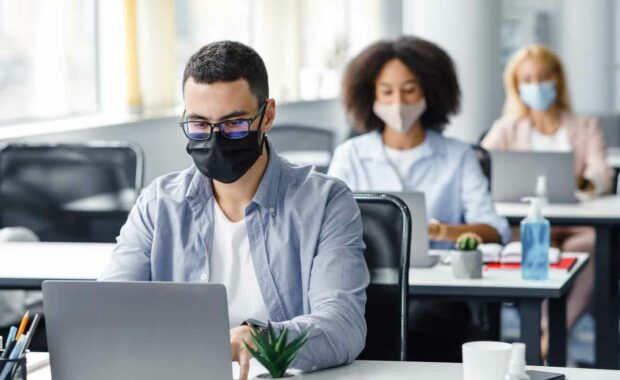 man working in office after covid pandemic