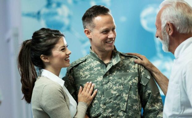 doctor communicating with military man and his wife after the appointment in the hospital