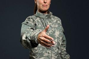 female veteran shaking hand