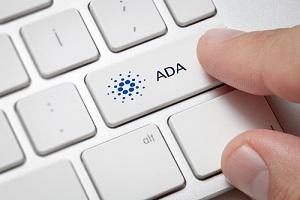 macro of male hand pressing computer key with cardano(ADA)
