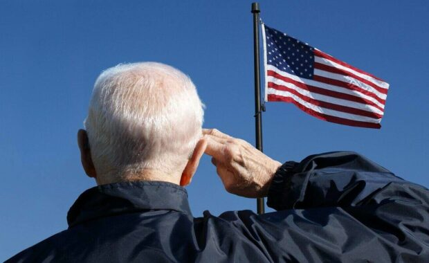 view of a veteran saluting the flag of the united states